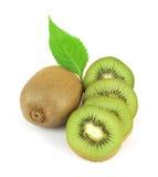 Whole kiwi fruit and its sliced segments Royalty Free Stock Photo