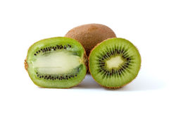 Whole kiwi and slices stock images