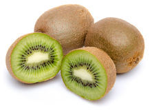 Whole kiwis and a kiwi fruit cut in half Stock Photography