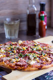 Whole large pizza on the board. Italian cuisine Stock Photo