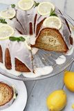 Lemon Bundt Cake with Missing Slices. Whole lemon cream cheese bundt cake with cream cheese filling in the center and missing slices. Extreme shallow depth of stock image