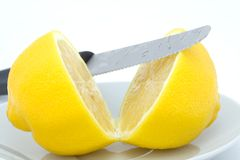 Whole lemon cut in halves Royalty Free Stock Images