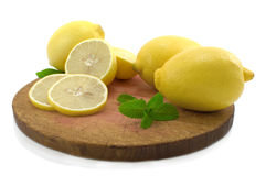 Whole lemon, half of lemon and lemon segment. Stock Photos