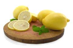 Whole lemon, half of lemon and lemon segment. Whole lemon, half of lemon and lemon segment with green mint stock photos