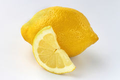 Whole lemon and lemon slice Stock Photo