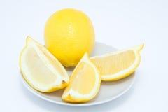 Whole lemon with lemon slices Royalty Free Stock Image