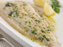 Whole Lemon Sole Meuniere with Lemon and Parsley Stock Images