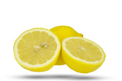 Whole lemon and two half slices. Royalty Free Stock Image