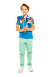 Whole-length picture of boy with different flags Royalty Free Stock Images