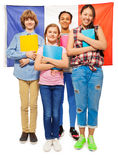 Whole-length picture of kids against French flag Stock Photo