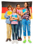 Whole-length picture of kids against German flag Royalty Free Stock Photo