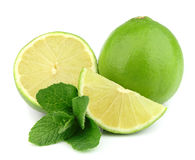 Whole lime and cut with mint Stock Photos