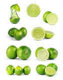 Whole lime fruit and slices isolated on white background with cl. Ipping path Royalty Free Stock Photos