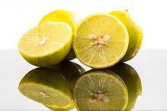 Whole lime and halves, close-up slices with water splashes.  stock photography