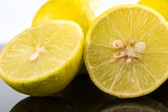 Whole lime and halves, close-up slices with water splashes.  royalty free stock photography