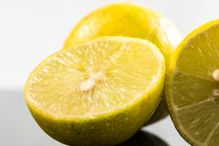Whole lime and halves, close-up slices with water splashes.  royalty free stock photo