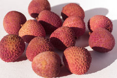 Whole litchis. On white background Stock Images