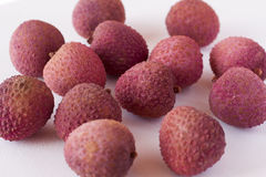 Whole litchis. On white background Royalty Free Stock Photos