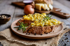 Whole meal bread slices with scrambled eggs, cheese and onion Royalty Free Stock Images