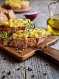 Whole meal bread slices with scrambled eggs, cheese and onion Stock Images