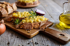 Whole meal bread slices with scrambled eggs, cheese and onion Royalty Free Stock Photo