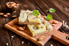 Whole meal pineapple cake with almonds royalty free stock image