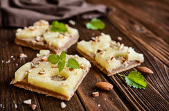 Whole meal pineapple cake with almonds stock image