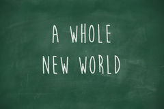 A whole new world handwritten on blackboard Royalty Free Stock Photos