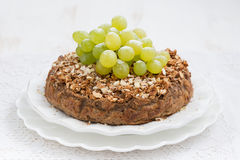 Whole nut pie with grapes Stock Photo