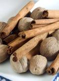 Whole nutmeg and cinnamon Stock Photography