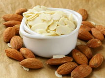 Whole nuts and blanched almonds Stock Photography