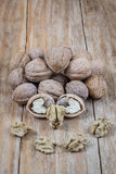 Whole nuts and peeled Royalty Free Stock Images