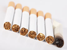 whole  and one not finished smoking cigarette Royalty Free Stock Photos