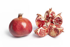 Whole and open Pomegranate Royalty Free Stock Images