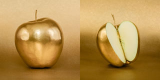 Whole and opened apple with golden peel on gold background Royalty Free Stock Image