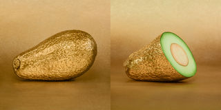 Whole and opened avocado with golden peel on gold background. Whole and opened golden avocado on gold background Stock Photos