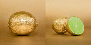 Whole and opened lime with golden peel on gold background Royalty Free Stock Photography