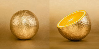 Whole and opened orange with golden peel on gold background Stock Image