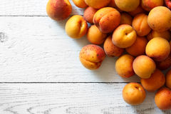 Whole orange apricots with red blush, from above, space for text Royalty Free Stock Photo