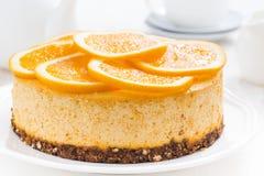 Whole orange cheesecake, close-up Royalty Free Stock Photo