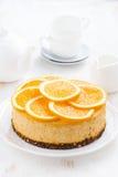 Whole orange cheesecake, vertical Stock Photo