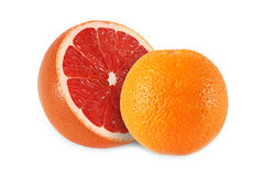 Whole orange and cut grapefruit isolated. On white background Royalty Free Stock Image
