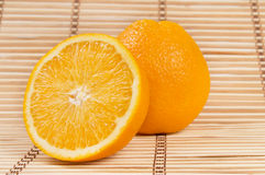 Whole orange fruit and his segments Stock Photography