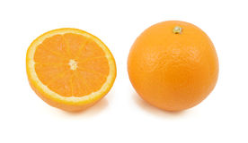 Whole orange and half fruit showing cross section Royalty Free Stock Photography