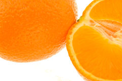 Whole orange and half orange Royalty Free Stock Image