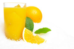 Whole orange with juice,ice cubes and leaves on snow on white Royalty Free Stock Photography