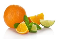Whole orange, lime and orange slices, spearmint Stock Photos