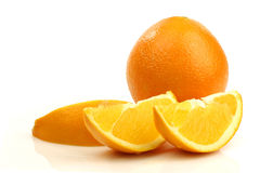 A whole orange and some pieces Stock Photography
