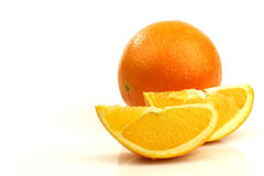 A whole orange and two pieces Royalty Free Stock Photography