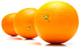Whole oranges. The ripe whole oranges on white, shallow DOF. Isolation Stock Photo